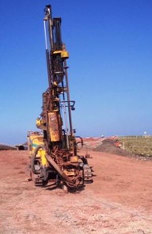 Blasting rig for drilling in explosives