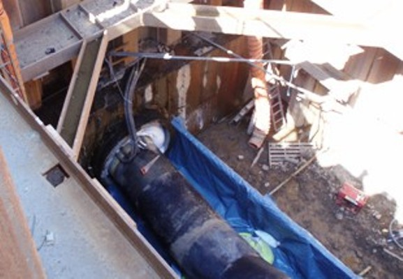 Grouting of the space between the carrier pipe and the product pipe