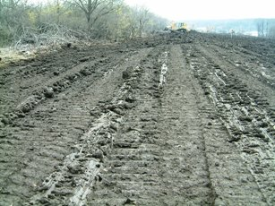 Topsoil panned by overworking in the wet