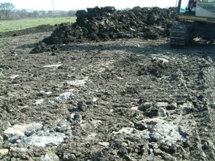 Rocks buried in topsoil, waiting for the plough